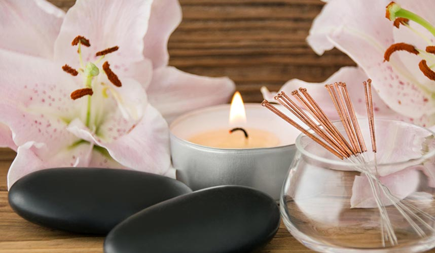 Acupuncture needles and massage stones
