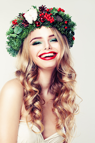 Beautiful woman wearing a holiday-inspired head wreath